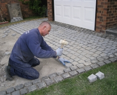 SPECKLED GREY GRANITE SETTS COMPLIMENT SIMONS BMW IN WESTHOUGHTON